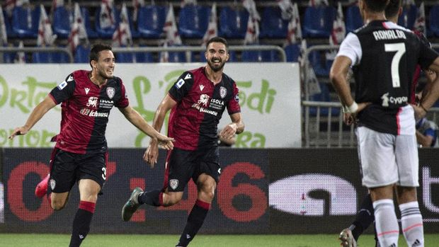Cagliari's Luca Gagliano, left, celebrates after scoring during the Serie A soccer match between Cagliari and Juventus, at the Sardegna Arena stadium, in Cagliari, Italy, Wednesday, July 29, 2020. (Alessandro Tocco/Lapresse via AP)