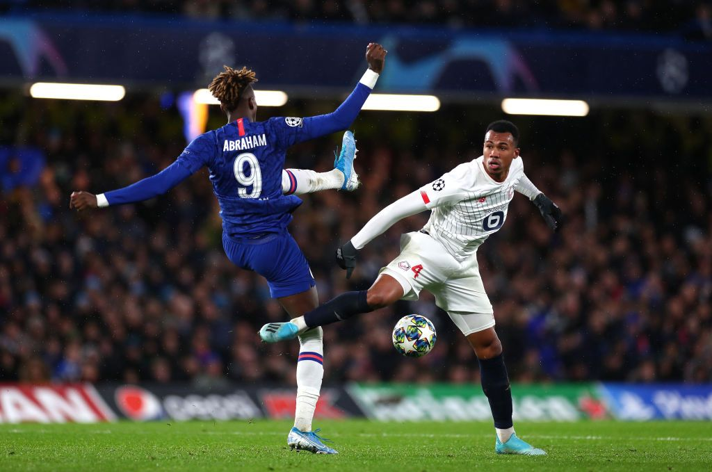 LONDON, ENGLAND - DECEMBER 10: Tammy Abraham of Chelsea and Gabriel of Lille  during the UEFA Champions League group H match between Chelsea FC and Lille OSC at Stamford Bridge on December 10, 2019 in London, United Kingdom. (Photo by Clive Rose/Getty Images)