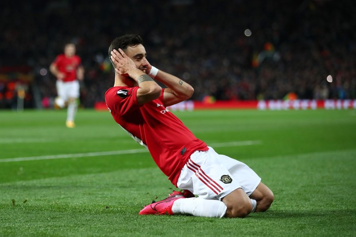 MANCHESTER, ENGLAND - FEBRUARY 27: Bruno Fernandes of Manchester United celebrates after scoring his teams first goal from the penalty spot during the UEFA Europa League round of 32 second leg match between Manchester United and Club Brugge at Old Trafford on February 27, 2020 in Manchester, United Kingdom. (Photo by Clive Brunskill/Getty Images)