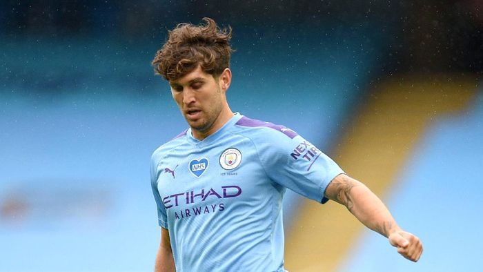 MANCHESTER, ENGLAND - JULY 08: John Stones of Manchester City in action during the Premier League match between Manchester City and Newcastle United at Etihad Stadium on July 08, 2020 in Manchester, England. Football Stadiums around Europe remain empty due to the Coronavirus Pandemic as Government social distancing laws prohibit fans inside venues resulting in all fixtures being played behind closed doors. (Photo by Oli Scarff/Pool viaGetty Images)