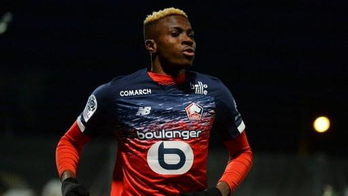 (FILES) This file photo taken on February 7, 2020 shows Lilles Nigerian forward Victor Osimhen celebrating scoring his teams first goal during the French L1 Football match between Angers SCO and Lille (LOSC), at Raymond-Kopa Stadium, in Angers, northwestern France. - Nigerian forward Victor Osimhen will join Naples (S.S.C. Napoli), the two football clubs announced on July 31, 2020. (Photo by JEAN-FRANCOIS MONIER / AFP)