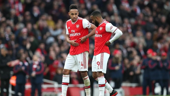 LONDON, ENGLAND - MARCH 07: Pierre-Emerick Aubameyang and Alexandre Lacazette of Arsenal talk following their sides victory in the Premier League match between Arsenal FC and West Ham United at Emirates Stadium on March 07, 2020 in London, United Kingdom. (Photo by Alex Morton/Getty Images)