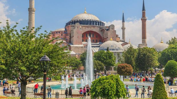 Photo of Hagia Sophia in Istanbul with fountain photographed from Sultanahmet Park during the day in cloudy skies and light cloud cover in May 2014