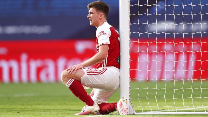 Arsenals Kieran Tierney leans against the post during the FA Cup final soccer match between Arsenal and Chelsea at Wembley stadium in London, England, Saturday, Aug.1, 2020. (Catherine Ivill/Pool via AP)