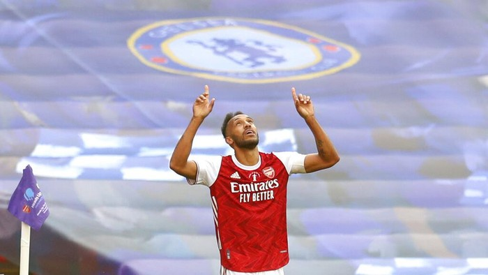 Arsenals Pierre-Emerick Aubameyang celebrates after scoring his sides second goal during the FA Cup final soccer match between Arsenal and Chelsea at Wembley stadium in London, England, Saturday, Aug.1, 2020. (Catherine Ivill/Pool via AP)