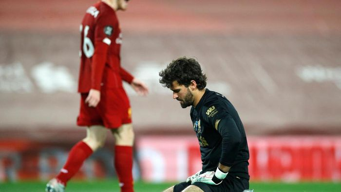 LIVERPOOL, ENGLAND - JULY 22: Alisson Becker of Liverpool reacts following Chelseas second goal, scored by Tammy Abraham of Chelsea (not pictured) during the Premier League match between Liverpool FC and Chelsea FC at Anfield on July 22, 2020 in Liverpool, England. Football Stadiums around Europe remain empty due to the Coronavirus Pandemic as Government social distancing laws prohibit fans inside venues resulting in all fixtures being played behind closed doors. (Photo by Phil Noble/Pool via Getty Images)