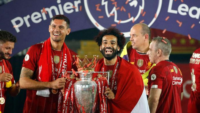 LIVERPOOL, ENGLAND - JULY 22: Dejan Lovren and Mohamed Salah of Liverpool celebrate with The Premier League trophy following the Premier League match between Liverpool FC and Chelsea FC at Anfield on July 22, 2020 in Liverpool, England. Football Stadiums around Europe remain empty due to the Coronavirus Pandemic as Government social distancing laws prohibit fans inside venues resulting in all fixtures being played behind closed doors. (Photo by Phil Noble/Pool via Getty Images)