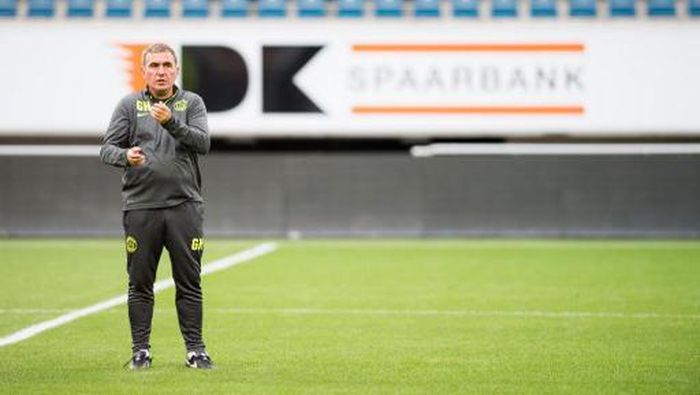 Viitoruls head coach Gheorghe Hagi gestures during a training session of Romanian team FC Viitorul Constanta, on July 27, 2016, in Gent on the eve the first leg of the third qualifying round in the Europa League competition against Belgian first league soccer team KAA Gent. (Photo by JASPER JACOBS / Belga / AFP) / Belgium OUT