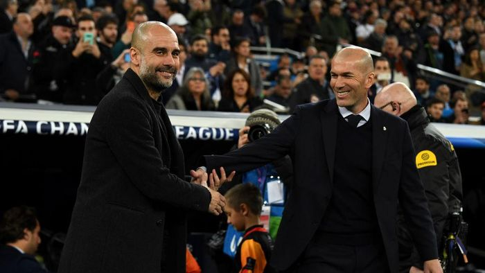 MADRID, SPAIN - FEBRUARY 26: Pep Guardiola, Manager of Manchester City shakes hands with Zinedine Zidane, Manager of Real Madrid prior to the UEFA Champions League round of 16 first leg match between Real Madrid and Manchester City at Bernabeu on February 26, 2020 in Madrid, Spain. (Photo by David Ramos/Getty Images)
