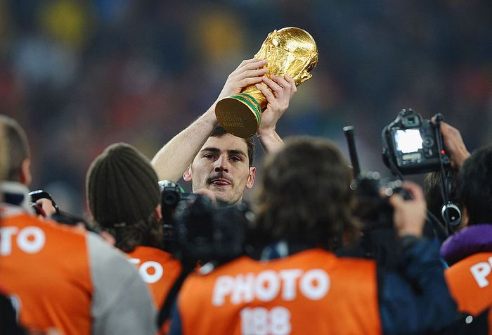 JOHANNESBURG, SOUTH AFRICA - JULY 11:  Iker Casillas of Spain lifts the World Cup trophy as the Spain team celebrate victory following the 2010 FIFA World Cup South Africa Final match between Netherlands and Spain at Soccer City Stadium on July 11, 2010 in Johannesburg, South Africa.  (Photo by Laurence Griffiths/Getty Images)