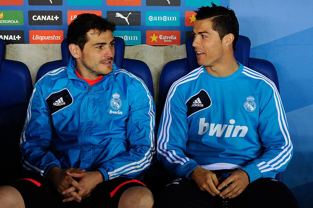 BARCELONA, SPAIN - MAY 11: Iker Casillas (L) and Cristiano Ronaldo of Real Madrid CF chat as they sit on the bench during the La Liga match between RCD Espanyol and Real Madrid CF at Cornella-El Prat Stadium on May 11, 2013 in Barcelona, Spain.  (Photo by David Ramos/Getty Images)