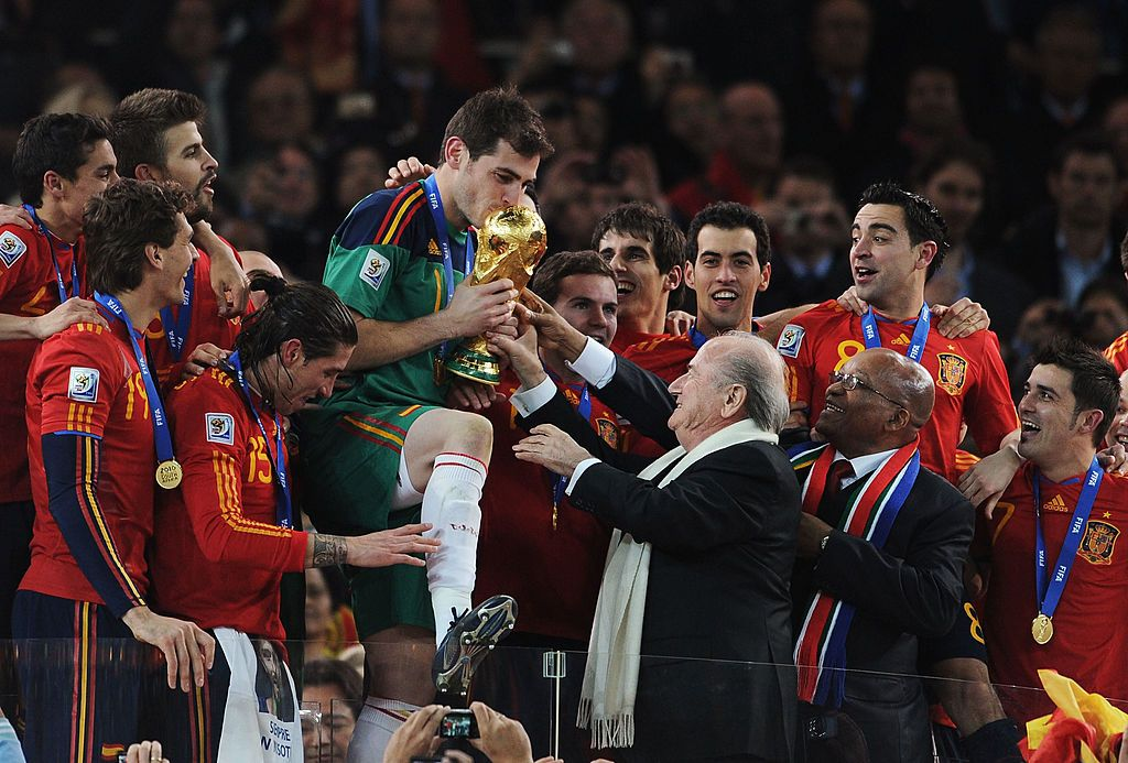 JOHANNESBURG, SOUTH AFRICA - JULY 11:  FIFA President Jospeph Sepp Blatter and South Africa President Jacob Zuma present the World Cup trophy to Iker Casillas, captain of Spain, following the 2010 FIFA World Cup South Africa Final match between Netherlands and Spain at Soccer City Stadium on July 11, 2010 in Johannesburg, South Africa.  (Photo by Jasper Juinen/Getty Images)