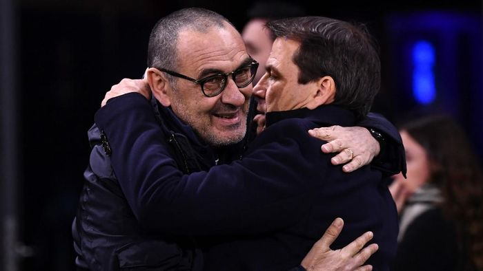 Juventus Italian coach Maurizio Sarri (L) embraces Lyons French head coach Rudi Garcia during the UEFA Champions League round of 16 first-leg football match between Lyon and Juventus at the Parc Olympique Lyonnais stadium in Decines-Charpieu, central-eastern France, on February 26, 2020. (Photo by FRANCK FIFE / AFP)