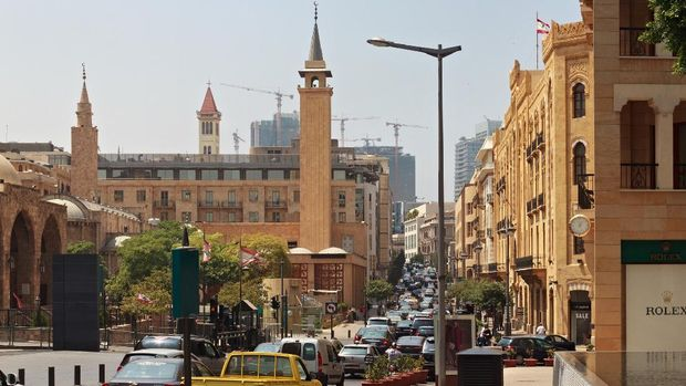 BEIRUT, LEBANON - AUGUST 14, 2014: Rush hour in Beirut downtown and view of the historical Al-Omari Grand Mosque at summer sunny day.