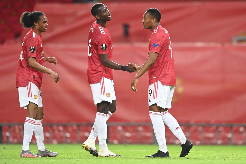 MANCHESTER, ENGLAND - AUGUST 05: Anthony Martial of Manchester United celebrates after scoring his sides second goal with Paul Pogba during the UEFA Europa League round of 16 second leg match between Manchester United and LASK at Old Trafford on August 05, 2020 in Manchester, England. (Photo by Michael Regan/Getty Images)