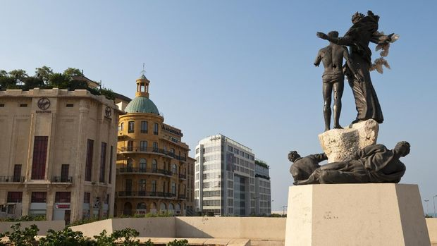 Beirut, Lebanon - August 27, 2010: A view from Martyrs Square. On the right is the landmark Martyrs Statue. On the left is a Virgin Megastore and Dunkin Donuts.