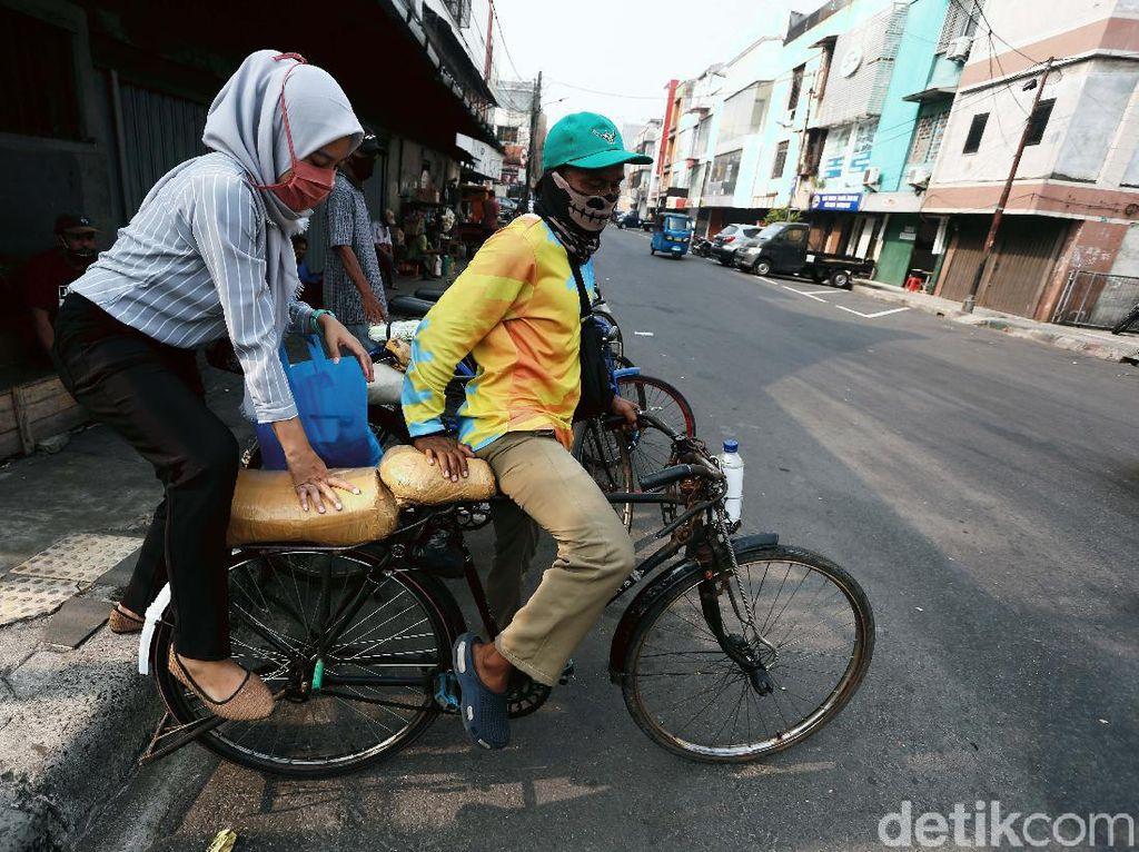 Tak Disentuh Aturan Baru, Ojek Sepeda Masih Bisa Wira-wiri