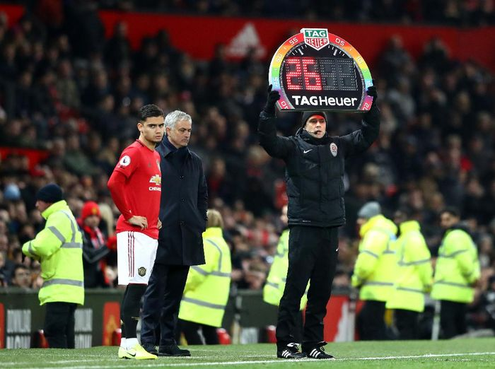 MANCHESTER, ENGLAND - DECEMBER 04: A Fourth official holds up a Stonewall Rainbow Laces branded substitution board  during the Premier League match between Manchester United and Tottenham Hotspur at Old Trafford on December 04, 2019 in Manchester, United Kingdom. (Photo by Michael Steele/Getty Images)