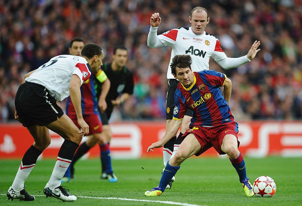 LONDON, ENGLAND - MAY 28:  Lionel Messi of FC Barcelona (R) in action against Rio Ferdinand (L) and Wayne Rooney (back) of Manchester United during the UEFA Champions League final between FC Barcelona and Manchester United FC at Wembley Stadium on May 28, 2011 in London, England.  (Photo by Laurence Griffiths/Getty Images)