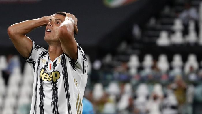 Juventus Cristiano Ronaldo reacts during the Champions League round of 16 second leg, soccer match between Juventus and Lyon at the Allianz stadium in Turin, Italy, Friday, Aug. 7, 2020. (AP Photo/Antonio Calanni)