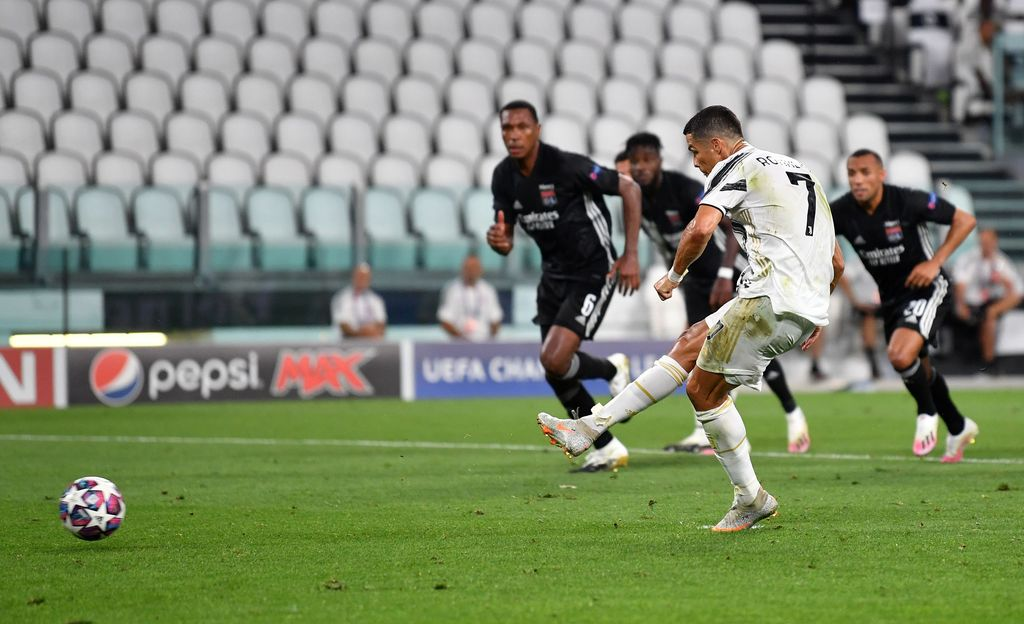 TURIN, ITALY - AUGUST 07: Cristiano Ronaldo of Juventus scores a penalty for his team's first goal during the UEFA Champions League round of 16 second leg match between Juventus and Olympique Lyon at Allianz Stadium on August 07, 2020 in Turin, Italy. (Photo by Valerio Pennicino/Getty Images)