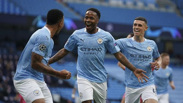 Manchester City's Raheem Sterling, center, celebrates after scoring the opening goal during the Champions League round of 16, second leg soccer match between Manchester City and Real Madrid at the Etihad Stadium in Manchester, England, Friday, Aug. 7, 2020. (AP Photo/Dave Thompson, Pool)