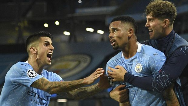 Manchester City's Gabriel Jesus celebrates after scoring his side's second goal during the Champions League, round of 16, second leg soccer match between Manchester City and Real Madrid at the Etihad Stadium in Manchester, England, Friday, Aug. 7, 2020. (Oli Scarff/Pool Photo via AP)