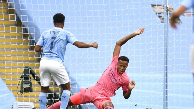 Manchester City's Raheem Sterling scores his side's first goal during the Champions League, round of 16, second leg soccer match between Manchester City and Real Madrid at the Etihad Stadium stadium in Manchester, England, Friday, Aug. 7, 2020. (Peter Powell/Pool Photo via AP)