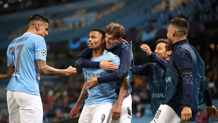 MANCHESTER, ENGLAND - AUGUST 07: Gabriel Jesus of Manchester City celebrates with teammates after scoring his teams second goal during the UEFA Champions League round of 16 second leg match between Manchester City and Real Madrid at Etihad Stadium on August 07, 2020 in Manchester, England. (Photo by Nick Potts/Pool via Getty Images)