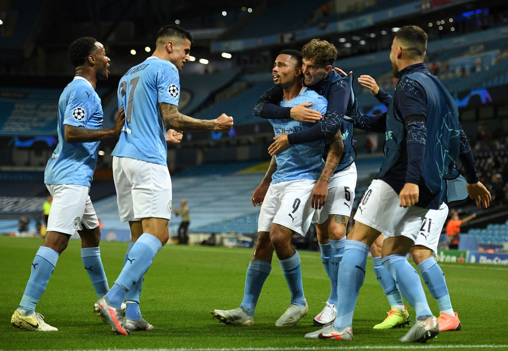 MANCHESTER, ENGLAND - AUGUST 07: Gabriel Jesus of Manchester City celebrates with teammates after scoring his team's second goal during the UEFA Champions League round of 16 second leg match between Manchester City and Real Madrid at Etihad Stadium on August 07, 2020 in Manchester, England. (Photo by Oli Scarff/Pool via Getty Images)