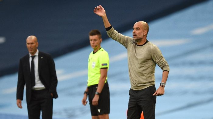 MANCHESTER, ENGLAND - AUGUST 07: Pep Guardiola, Manager of Manchester City gives his team instructions during the UEFA Champions League round of 16 second leg match between Manchester City and Real Madrid at Etihad Stadium on August 07, 2020 in Manchester, England. (Photo by Oli Scarff/Pool via Getty Images)
