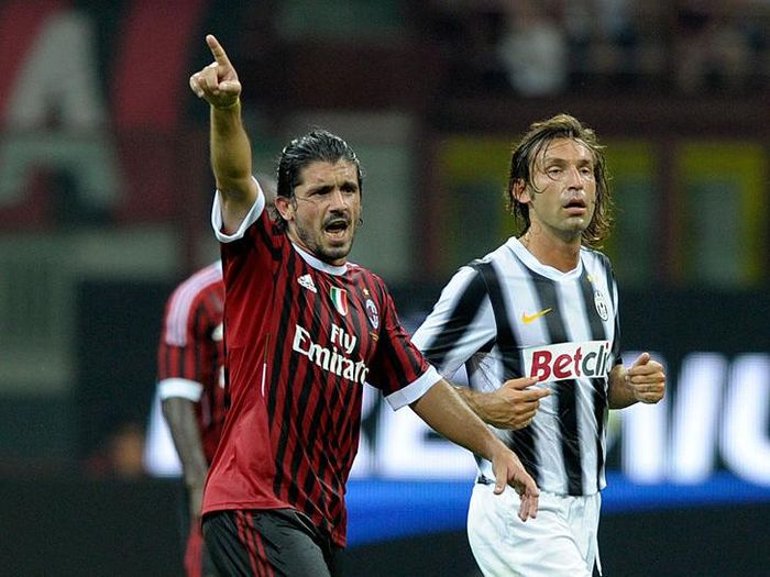 MILAN, ITALY - AUGUST 21:  Gennaro Gattuso of AC Milan and Andrea Pirlo of Juventus FC during the Berlusconi Trophy match between AC Milan and Juventus FC at Giuseppe Meazza Stadium on August 21, 2011 in Milan, Italy.  (Photo by Claudio Villa/Getty Images)