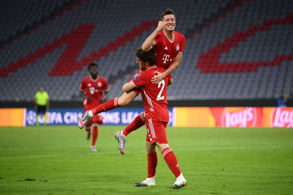 MUNICH, GERMANY - AUGUST 08: Robert Lewandowski of Bayern Munich celebrates with Alvaro Odriozola Arzallus of Bayern Munich after scoring his sides fourth goal during the UEFA Champions League round of 16 second leg match between FC Bayern Muenchen and Chelsea FC at Allianz Arena on August 08, 2020 in Munich, Germany. (Photo by Matthias Hangst/Getty Images)