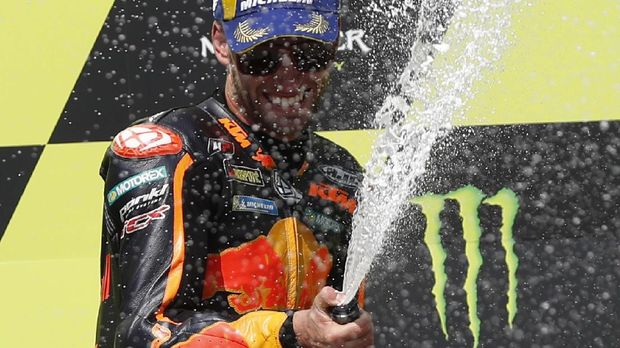 South African rider Brad Binder celebrates wining the MotoGP at the Czech Republic motorcycle Grand Prix at the Automotodrom Brno, in Brno, Czech Republic, Sunday, Aug. 9, 2020. (AP Photo/Petr David Josek)