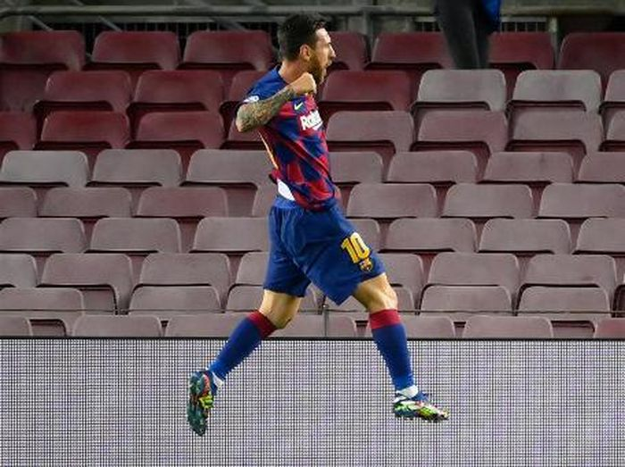 Barcelonas Argentine forward Lionel Messi celebrates after scoring a goal during the UEFA Champions League round of 16 second leg football match between FC Barcelona and Napoli at the Camp Nou stadium in Barcelona on August 8, 2020. (Photo by LLUIS GENE / AFP)
