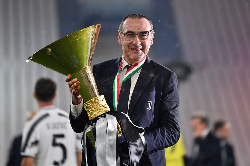 TURIN, ITALY - AUGUST 01: Juventus FC head coach, Maurizio Sarri, celebrates with the trophy after the Serie A match between Juventus and  AS Roma at Allianz Stadium on August 1, 2020 in Turin, Italy.  (Photo by Valerio Pennicino/Getty Images)