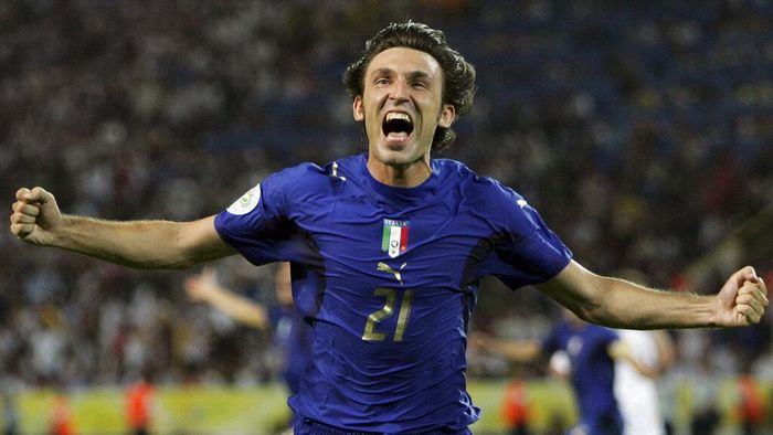 FILE - In this Tuesday, July 4, 2006 filer, Italys Andrea Pirlo celebrates his sides first goal by teammate Fabio Grosso in the extra time of the semifinal World Cup soccer match between Germany and Italy in Dortmund, Germany. World Cup winner Pirlo was named Thursday, July 30, 2020, coach of Juventus' under-23 team, which plays in Serie C. (AP Photo/Andrew Medichini, File)