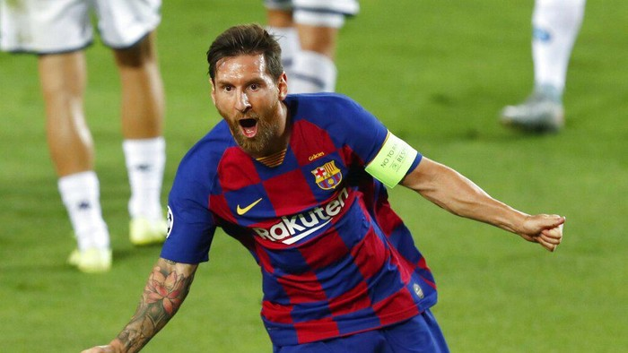 Barcelonas Lionel Messi celebrates after scoring his sides second goal during the Champions League round of 16, second leg soccer match between Barcelona and Napoli at the Camp Nou Stadium in Barcelona, Spain, Saturday, Aug. 8, 2020. (AP Photo/Joan Monfort)