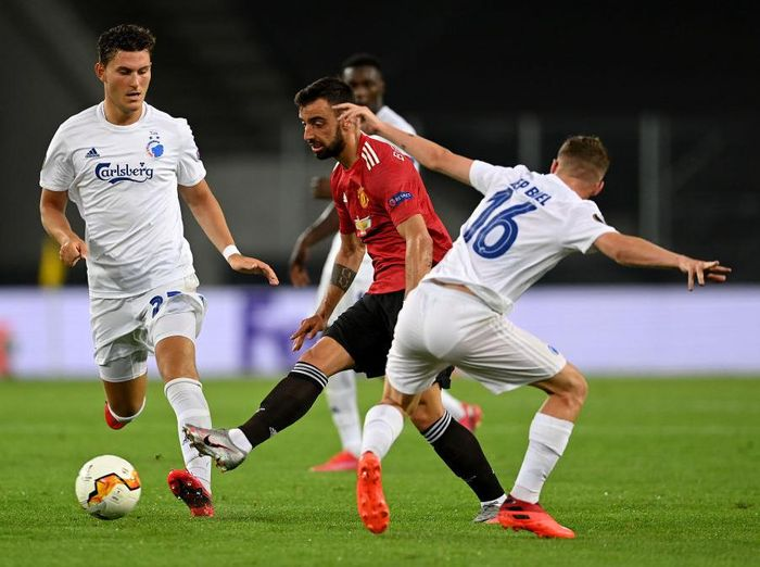 COLOGNE, GERMANY - AUGUST 10: Bruno Fernandes of Manchester United is challenged by Pep Biel of FC Kobenhavn during the UEFA Europa League Quarter Final between Manchester United and FC Kobenhavn at RheinEnergieStadion on August 10, 2020 in Cologne, Germany. (Photo by Sascha Steinbach/Pool via Getty Images)