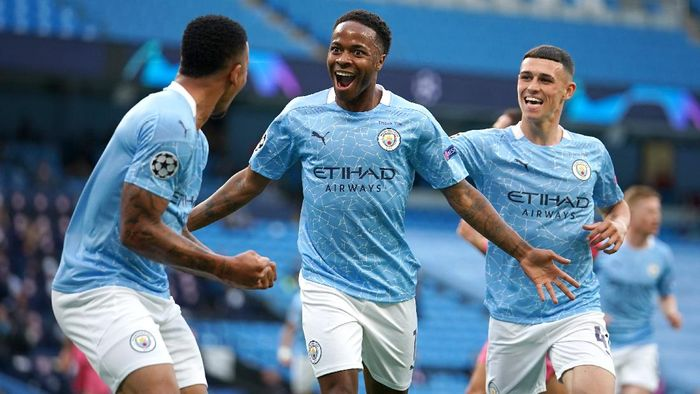 MANCHESTER, ENGLAND - AUGUST 07: Raheem Sterling of Manchester City celebrates with teammates Gabriel Jesus and Phil Foden after scoring his teams first goal during the UEFA Champions League round of 16 second leg match between Manchester City and Real Madrid at Etihad Stadium on August 07, 2020 in Manchester, England. (Photo by Dave Thompson/Pool via Getty Images)