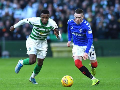 GLASGOW, SCOTLAND - DECEMBER 29: Boli Bolingoli of Celtic  and Ryan Kent of Rangers battle for possession during the Ladbrokes Premiership match between Celtic and Rangers at Celtic Park on December 29, 2019 in Glasgow, Scotland. (Photo by Mark Runnacles/Getty Images)