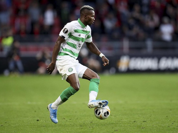 "FILE - In this Thursday, Sept. 19, 2019 file photo, Celtics Boli Bolingoli-Mbombo controls the ball during the Europa League Group E soccer match between Rennes and Celtic, at the Roazhon Park stadium in Rennes, France. Scottish soccer is in danger of being halted by the country's government after a Celtic player breached coronavirus rules by taking a secret trip to Spain and failing to self-isolate on his return. The Scottish champions have begun a ""full investigation"" into the actions of left back Boli Bolingoli, it was reported on Tuesday, Aug. 11, 2020. (AP Photo/David Vincent, File)"