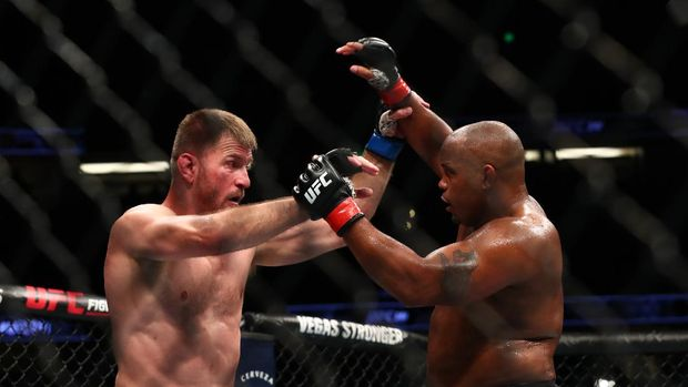 ANAHEIM, CALIFORNIA - AUGUST 17: Daniel Cormier throws a punch at Stipe Miocic in the second round during their UFC Heavyweight Title Bout at UFC 241 at Honda Center on August 17, 2019 in Anaheim, California.   Joe Scarnici/Getty Images/AFP