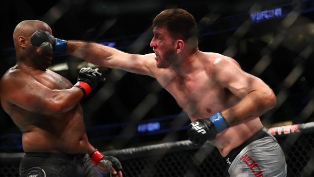 ANAHEIM, CALIFORNIA - AUGUST 17: Stipe Miocic throws a punch at Daniel Cormier in the second round during their UFC Heavyweight Title Bout at UFC 241 at Honda Center on August 17, 2019 in Anaheim, California.   Joe Scarnici/Getty Images/AFP