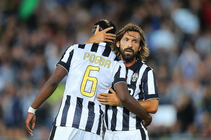 SYDNEY, AUSTRALIA - AUGUST 10: Paul Pogba (L) of Juventus celebrates his goal with Andrea Pirlo of Juventus during the match between the A-League All Stars and Juventus at ANZ Stadium on August 10, 2014 in Sydney, Australia.  (Photo by Joosep Martinson/Getty Images)