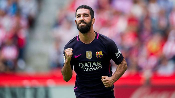 GIJON, SPAIN - SEPTEMBER 24:  Arda Turan of FC Barcelona celebrates after scoring his teams fourth goal during the La Liga match between Real Sporting de Gijon and FC Barcelona at Estadio El Molinon on September 24, 2016 in Gijon, Spain.  (Photo by Juan Manuel Serrano Arce/Getty Images)