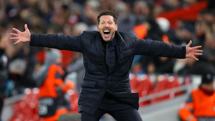 LIVERPOOL, ENGLAND - MARCH 11: Diego Simeone, Manager of Atletico Madrid celebrates after they score their second goal during the UEFA Champions League round of 16 second leg match between Liverpool FC and Atletico Madrid at Anfield on March 11, 2020 in Liverpool, United Kingdom.  (Photo by Julian Finney/Getty Images)