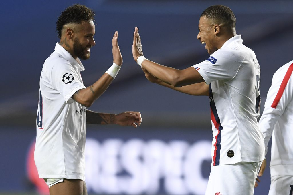 PSG's Neymar, left, celebrates with teammate PSG's Kylian Mbappe, right, after his team's win in the Champions League quarterfinal match between Atalanta and PSG at Luz stadium, Lisbon, Portugal, Wednesday, Aug. 12, 2020. (David Ramos/Pool Photo via AP)