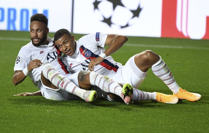 PSGs Neymar, left, celebrates with Kylian Mbappe after teammate Eric Maxim Choupo-Moting scored his teams second goal during the Champions League quarterfinal match between Atalanta and PSG at Luz stadium, Lisbon, Portugal, Wednesday, Aug. 12, 2020. (David Ramos/Pool Photo via AP)