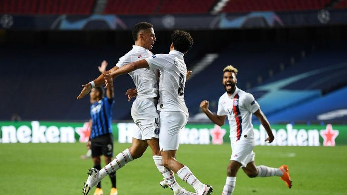 LISBON, PORTUGAL - AUGUST 12: Marquinhos of Paris Saint-Germain celebrates after scoring his teams first goal during the UEFA Champions League Quarter Final match between Atalanta and Paris Saint-Germain at Estadio do Sport Lisboa e Benfica on August 12, 2020 in Lisbon, Portugal. (Photo by David Ramos/Getty Images)